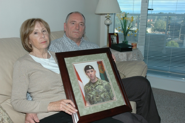 Sheila and Shaun Fynes show a photo of their son Cpl. Stuart Langridge, a Canadian Forces soldier who committed suicide.