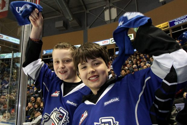 Eleven-year-olds Josh Gitzel, left, and Matthew Perry both 11 cheers on the Victoria Royals in their first playoff home game against the Kamloops Blazers at Save-on-Foods Memorial Centre on Tuesday night.