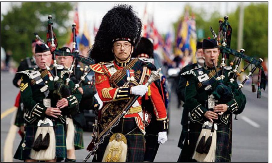The Canadian Scottish Regiment Pipes and Drums band marches down Douglas Street. Entries for this year are due April 5.