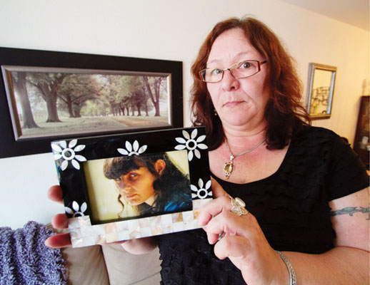 Rachelle Warner with a photo of her daughter, Marilynne Neill, last seen on Feb. 16, 2003. Neill would be 40 this year.