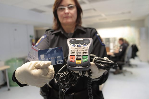 Saanich Const. Petra Dornblut, with evidence seized from this massive credit card and PIN-pad fraud investigation