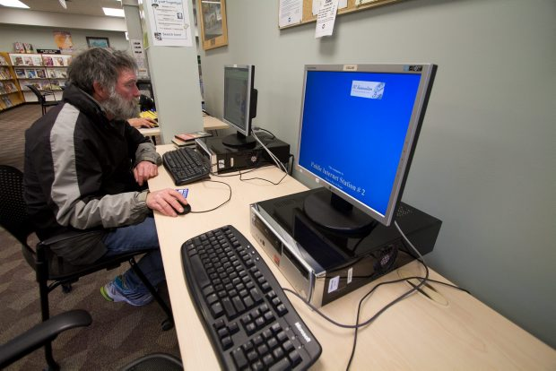 Jeff McBride uses a public access computer at the Central Saanich Library.