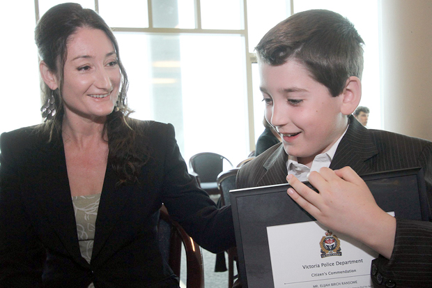 Meet 10-year-old Elijah Ransome, the youngest recipient of the Victoria police's citizen commendation, awarded for his quick response after his mother, Janice Jensen, left, suffered a seizure.