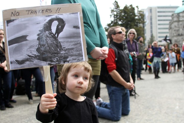 Holly Ladret, 2, takes part in a protest against the proposed Northern Gateway pipeline in front of the B.C. legislature on Sunday, April 15, 2012.