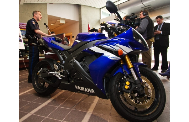 Saanich Police Sgt. Dean Jantzen with the blue Yamaha motorcycle seen in a Youtube video travelling almost 300 kilometres per hour down the Trans Canada Highway