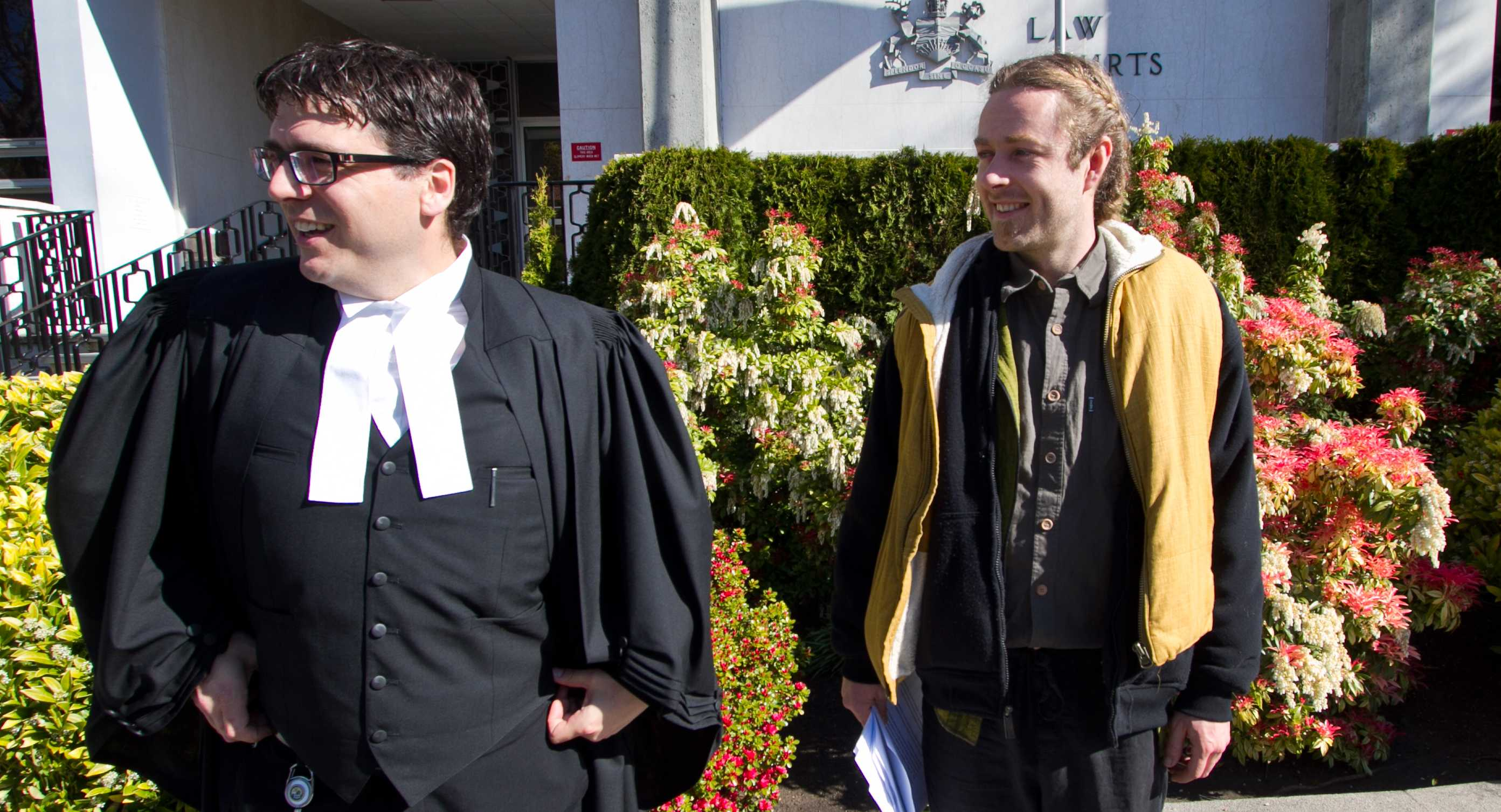 Lawyer Kirk Tousaw, left, and medical marijuana case defendant Owen Smith outside of court in Victoria on April 13, 2012.