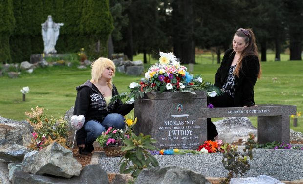 Lisa Twiddy, right, and her 14-year-old daughter, Brittney Rigo, at Hatley Memorial Gardens, where Nic Twiddy is buried. Nic was killed in a car crash on Sooke Road on April 9.