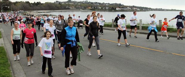 Participants run and walk along Dallas Road during the Times Colonist 10K.