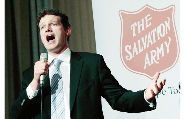 Ken Lavigne sings at the Salvation Army annual luncheon Wednesday.