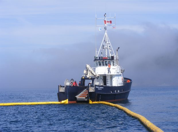 An oil-containing boom is laid out from one of Western Canada Marine Response Corp.'s 28 spill-response vessels.