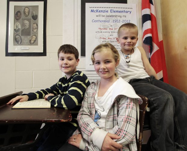 Sarah Maude, 9, foreground, Owen Maude, 7, right, and Grayson Hall, 9, are third-generation students at Mckenzie Elementary School, which is celebrating its 100th anniversary.