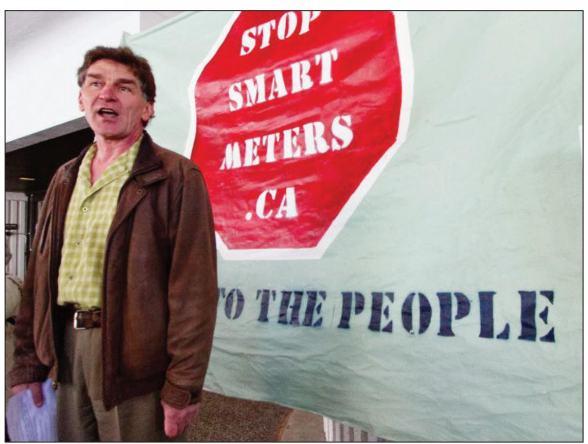 Steve Satow talks to Supporters of StopSmartMeters.ca at a rally outside of the Ministry of Health on Blanshard Street on Wednesday.