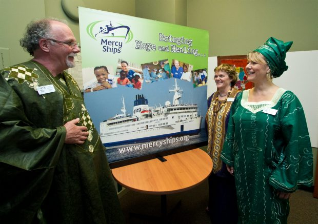 Tim Maloney, Lorraine McDonald and Maria Manna dressed in African outfits for a fundraising lunch at the Victoria office of Mercy Ships, a non-governmental ship-based medical organization. Money raised will go toward its Mothers in May effort to fund women's surgeries in West Africa.
