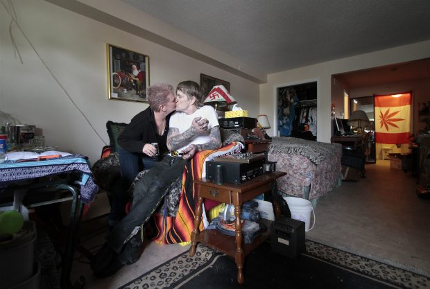 "Doug Chipera and his partner, Pat Pinnock, in their newly renovated room at Queens Manor on Tuesday. Chipera says the housing has helped him ""get back on the right path."""