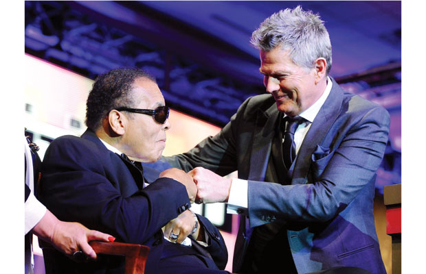 Victoria's David Foster, right, bumps fists with Muhammad Ali on stage at Celebrity Fight Night XVIII on March 24 in Phoenix. Foster and Ali will pair up again this weekend at David Foster Foundation's Miracle Concert and Gala. The 25th anniversary Miracle Weekend begins today at 6 a.m. with a 12-hour radiothon.