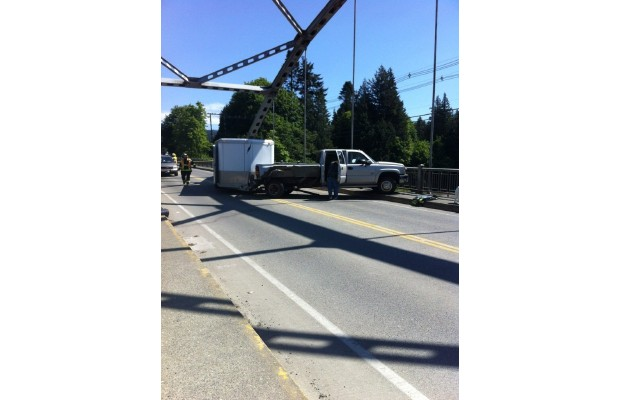 A jack-knifed pickup truck is blocking traffic coming in and out of Sooke.