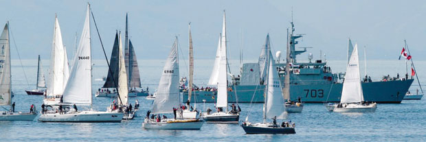 Boats taking part in the Swiftsure International Yacht Race off Clover Point Saturday as their crews wait for wind.