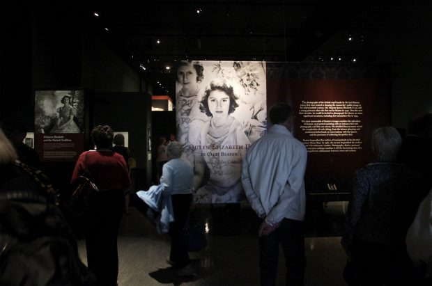 Guests view portraits of the Queen by British photographer Cecil Beaton during a preview at the Royal B.C. Museum Thursday. The exhibition to mark the Diamond Jubilee begins today.