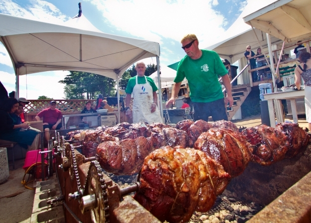 Rob Westfall, right, and Bill Westfall prepare roast beef at the Oak Bay Tea Party at Willows Beach on Saturday.