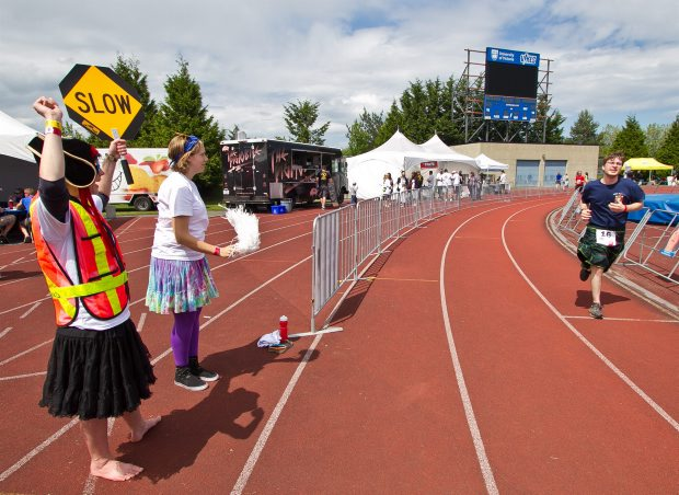 Larissa Korns, left, and Darby MacWilliam cheer on a participant in the 18th annual Vancouver Island Money Mart Easter Seals 24-hour Relay for The Kids at Centennial Stadium Saturday.
