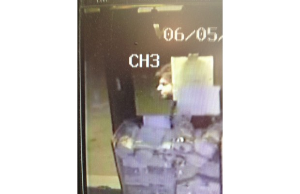 Surveillance footage of the suspect who taped homophobic and anti-immigrant notes on the window of Aubergine Specialty Foods in Fernwood on Tuesday.