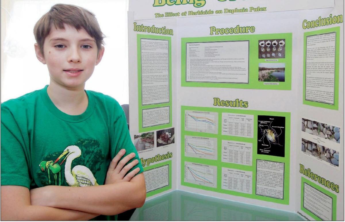 Grade 7 student Adrian Chlysta poses with his Vancouver Island Regional Science Fair project at his home in Victoria.
