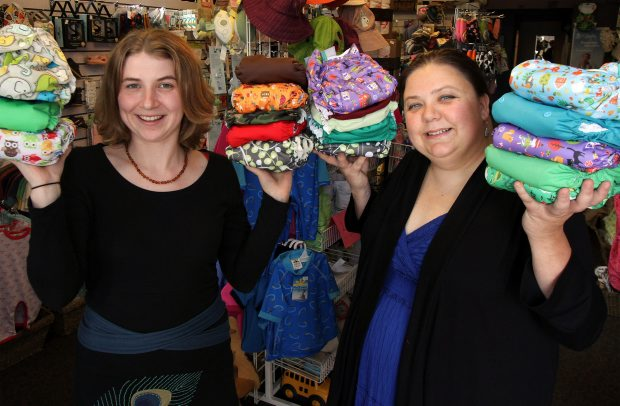 Cloth diaper advocates Stephanie Baird, left, and Rachel Aube show off some of the options available at Abby Sprouts in Victoria on Tuesday.