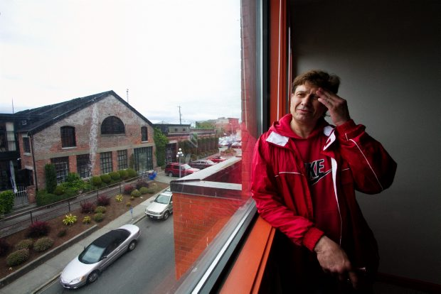 Resident Kurtis Wilson, 52, checks out the view from his apartment at Swift House, a supportive-housing development at the former Streetlink shelter on Swift Street.