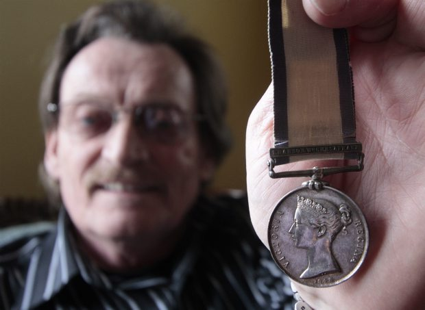 Mike Gifford holds the medal that was given to his great, great grandfather, who was onboard HMS Shannon when it defeated the American ship, the Chesapeake, during the War of 1812.