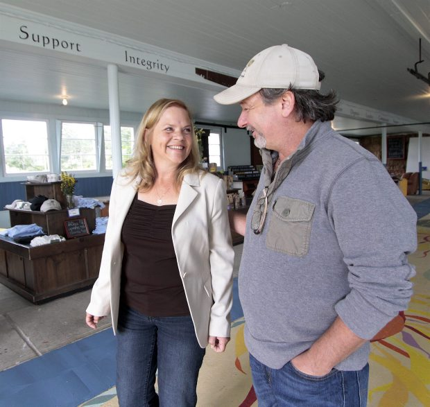 Louise Chabros, founder of Close to Home, talks with Richard Leblanc of the Creating Homefulness Society on Tuesday at Woodwynn Farms.