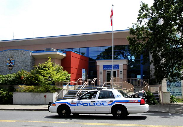 A police car cruises by Esquimalt municipal hall on Wednesday. The provincial government ordered Esquimalt to stay with the Victoria police and plans to change the name of the force to the Victoria-Esquimalt Police Department.