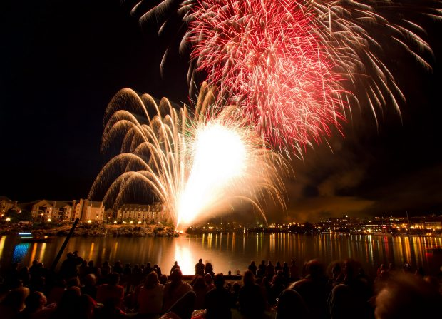Crowds watch fireworks in the Inner Harbour on July 1 last year. This year's show starts at 10:20 p.m. Sunday.