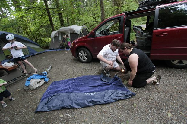 Campers Cindy Abbott and Stephen Perestam inflate a mattress at Goldstream Provincial Park on Friday.