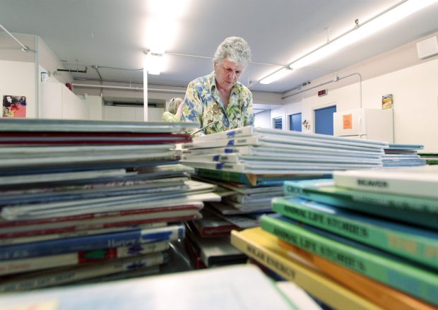 Lorraine Borstad sorts books at the Saanichton Lsarning Centre for the 1000 x 5 Children's Book Recycling Project.