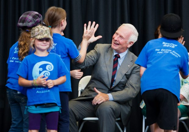 Gov. Gen. David Johnston high-fives children at the official launch of the Victoria Foundation's Smart & Caring Community Fund at the Pacific Institute fpr Sports Excellence on Thursday.