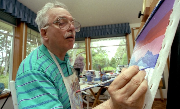 Ted Harrison was enjoying painting at his home in Oak Bay in July 1993 when this photo was taken.