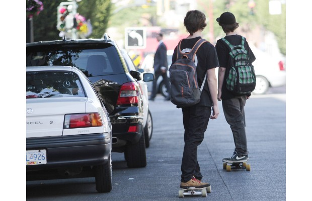 Skateboards roll along Government Street on Wednesday.