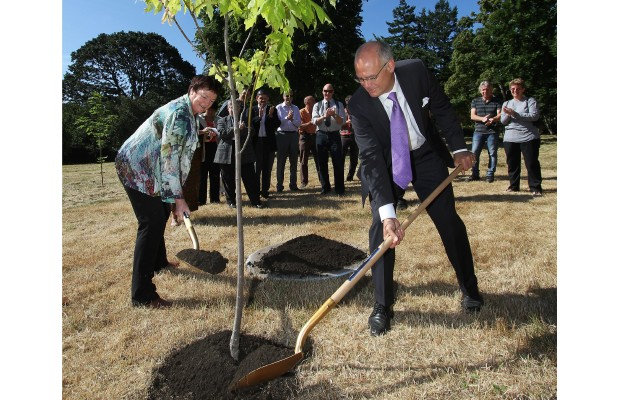 Mayor Dean Fortin, left, and visiting sister-city Mayor Barbara Arnott of Napier, New Zealand, plant a ceremonial maple tree in the Mayor's Grove at Beacon Hill Park on Wednesday.