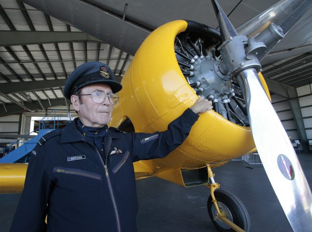 Harry Addison stands next to a refurbished Harvard at the B.C. Aviation Museum in Sidney on Saturday.