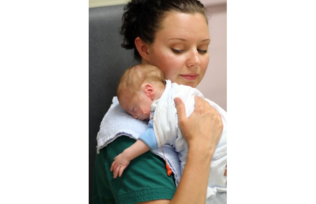 Nurse Sara Moore tends to six-week old Quillan Lockley in Victoria General Hospital's neo-natal intensive care uniye, the same place Moore was cared for as a premature baby.