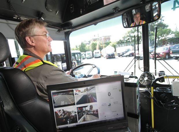 Times Colonist reporter Richard Watts prepares to drive a B.C. Transit bus under the watchful eye of several cameras.