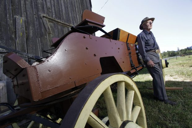 Alan Pugh, 89, with a wagon from the turn of the 20th century that he restored. Many of the more than two dozen buggies, carriages and pieces of antique farm equipment at his West Saanich Road farm come with memories.