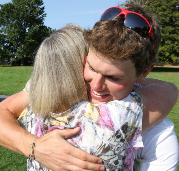 Sean Jacklin hugs his mother Sharon Jacklin after he returns to Mile Zero.