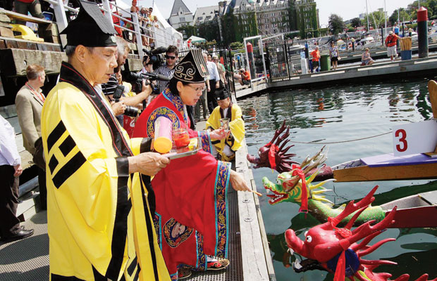 Members of the Evergreen Taoist Church of Canada prepare to bless the boats for the 18th annual Canada Dry Victoria Dragon Boat Festival in Victoria's Inner Harbour Friday.
