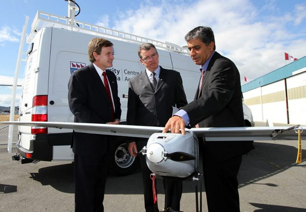 The Federal government is announcing funding for UVic's .  North Vancouver MP David Saxton, left, University of Victoria president David Turpin and Prof. Afzal Suleman look at an unmanned aerial vehicle at a funding announcement for UVic's Centre fro Aerospace Research on Aug. 23, 2012.