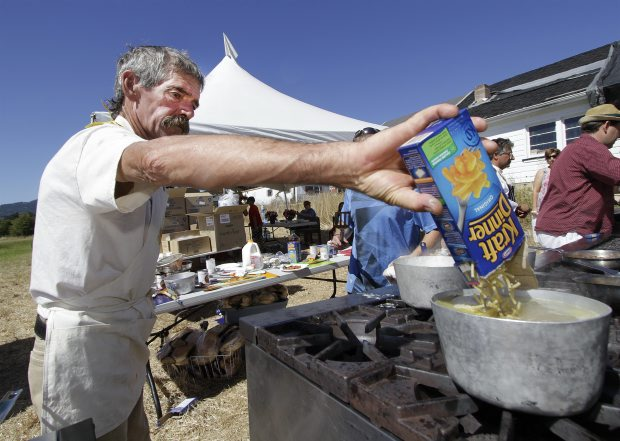 Cook Tim Summers with his special ingredient during the Kraft Dinner cook-off at Woodwynn Farms fundraiser, We Believe, on Saturday.