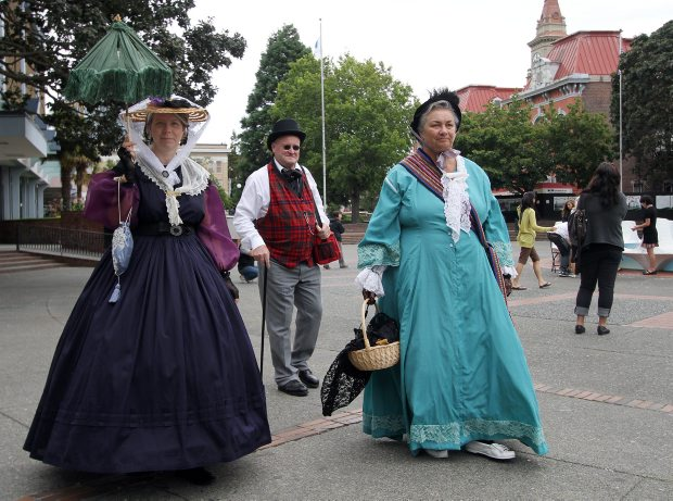 Lynda Witham, left, Mark and Fern Perkins take part in the Community Arts Council of Greater Victoria's afternoon of songs, dances and games from Victoria's past Sunday at Centennial Square.
